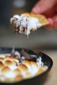Skillet S'mores Recipe ; Chocolate and marshmallows baked in the oven and served with graham crackers