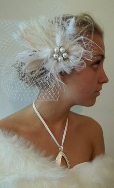 Bridal french net veil with ivory  peacock feather, white feathers,  rhinestone and pearl center fascinator