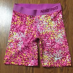 NIKE PRO SPANDEX COMPRESSION SHORTS DOTTED Excellent condition, like new. Only flaw is the security tag left an imprint. Will probably fade with washing though. See pictures. Adorable spotted pattern with purple pink and yellow. Nike Shorts