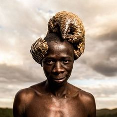 This man is from Zimbabwe/the Pangolin tribe. They spend their lives protecting the Elephants (I believe)