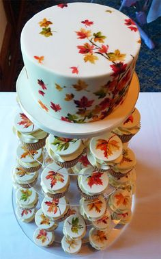 colorful wedding cakes Preparing for your autumn nuptials Beautiful colored fall leaves are an amazing way to highlight the season and add a cozy charming vibe to your wedding. Fall Wedding Cakes, Wedding Cakes With Cupcakes, Themed Cupcakes, Cupcake Cakes, Wedding Favors, Wedding Ideas, Wedding Planning, Cupcake Ideas, Beautiful Cakes