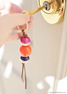 Housewarming gift: A simple key fob or key chain to keep track of new keys! A related gift could be a simple, modern key rack.