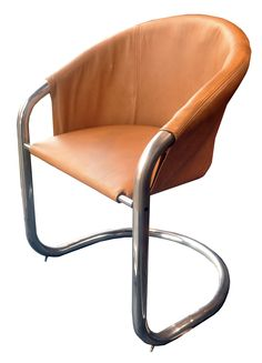 This unusual accent chair has so much style! A perfectly suspended chrome frame is wrapped in an original light caramel leather with just the right amount of wear-and-tear. The chair is in great condition with a bit of discoloring on the frame. A comfortable seat and a great piece to look at!