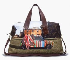 A Mini Cooper is pictured on this fun holdall from Paul Smith. The canvas bag features brown leather contrast details, in addition to exposed zip compartment