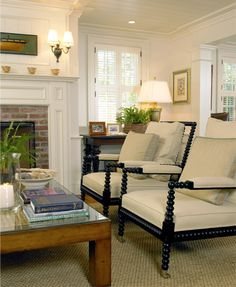 patrick ahearn: black spindle chairs with ivory upholstery + rustic coffee table + white millwork