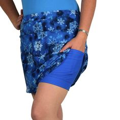 """SparkleSkirts SlimCut SnowDay Channel your favorite snow princess in this blue and white slim cut athletic skirt! The intense royal blue anti-ride EVS undershorts help wick away sweat and prevent chafing. Gels, phone, music player, keys. Check! There's plenty of room for all those essentials in two 5x5"""" pockets and a 12"""" zippered waistband pocket that can be worn front or back. Pair this snowy beauty with our SnowQueen Character Cape and PrincessSleeves for the complete princess look!"""