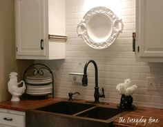 Copper sink and faux brick back splash.