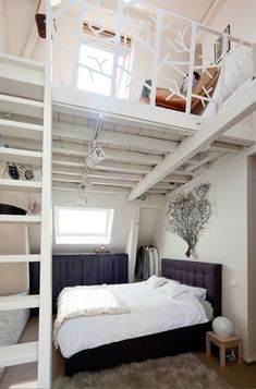 lofted bedroom nook and closet in small space | tree/branch railing