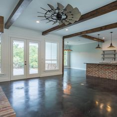 We can't decide what we love most about this open concept living, kitchen and dining room. The beams? The brick? The ceiling fan? The floor plan and the combination of all the features make for an incredible entertaining space. #beams #brick #interiordesign #floorplan #newhome #customhomes #tonymillerconstrcution #openconcept #openconceptliving #dfw #northtexascustomhomes #wcw #dallastx #customhomebuilder