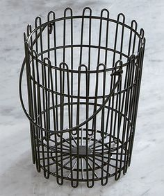 """7""""T x 5.5""""D LOVE!LOVE!WANT!WANT!  isplay a bunch of bananas or a cornucopia of veggies with the help of this kitchen caddy. Constructed from intertwined, powder-coated wire and featuring a maneuverable handle, it's the perfect place to show off fresh farmers' market finds."""