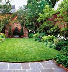 Mini lawn and garden inside a small walled area.