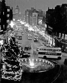 We love this festive photo of Sheffield in 1962 with a whole fleet of different buses on the now pedestrianised Fargate! // Town Hall Square looking towards Fargate showing Christmas Illuminations and Goodwin Fountain