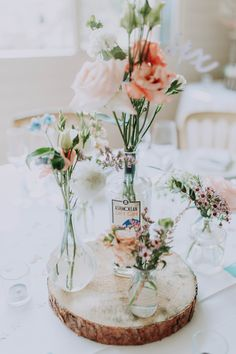 Wedding table centre pieces using gin bottles Wedding Table Centerpieces, Centrepieces, Wedding Centre Pieces, Wedding Spreadsheet, Bottle Fairy Lights, Fairy Lights Wedding, Our Wedding, Wedding Ideas, Gin Bottles