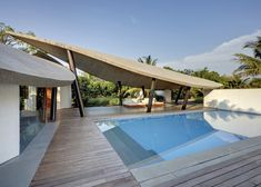 indoor-outdoor-home-india-sheltered-concrete-leaves-6-pool.jpg