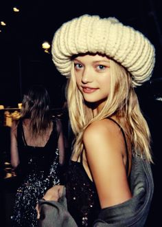 Why is she making that crazy hat look cute !