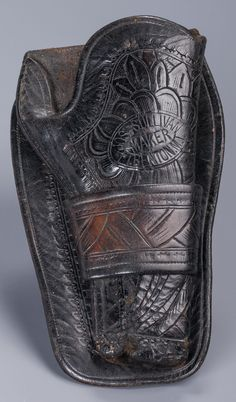 """Joseph Sullivan Territorial Holster Single loop, floral tooled holster for a 4 3/4"""" Colt Single Action Army. Dark color, well-marked """"Jos. Sullivan, Ft Benton, M.T."""""""