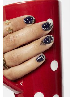 Paint two coats of navy, then gentle dip your wet nails into white crystal beads. Follow with a topcoat to keep the crystals in place. Apply temporary cuticle tattoos for extra edge! MORE: How To Apply Caviar Beads!   - Seventeen.com