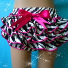 Zebra Ruffle Bloomer with Hot Pink bow on Lish, $15.38 USD