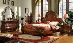 """5 pc Classique collection dark brown wood burl ornately carved Queen bedroom set with brushed gold accents. This set includes the Queen bed set, 1 - Nightstand, 1 - Dresser, 1 - Mirror and 1 - Chest. Additional pieces also available separately. Queen bed measures 69 1/2"""" x 91"""" x 67"""" H. Nightstand measures 32"""" x 20"""" x 30"""" H. Dresser measures 68"""" x 20"""" x 38 1/2"""" H. Mirror measures 52"""" x 47"""" H. Chest measures 42"""" x 20 1/4"""" x 56"""" H.  SKU MFB16001"""