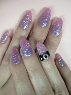 Pastel glitter nails with eye decoration