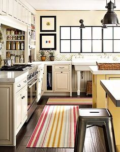 hidden shelves near stove, two islands, great sink... Can a kitchen get any cozier!?