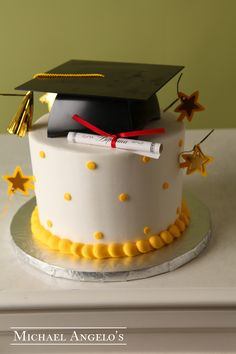 Polka Dots & Stars #31Graduation  This cake is iced in buttercream and can be colored to match any school or theme. Small or large polka dots are great accents along with the fondant cut-outs of the graduation year. The graduation cap and diploma also make this cake look complete for anyone graduating.