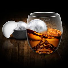 On The Rock Glass + Ice Ball  Now this is more like it. A giant ball of ice mold that melts slowly and cools your drink quickly paired with a glass that has a mountain at the bottom. This facilitates the rolling motion and evenly cools your drink. Not bad!