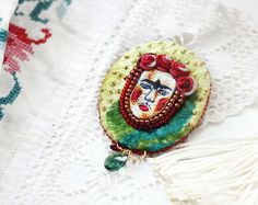 Plush brooch, embroidered portrait of Frida Kahlo, Embroidered brooch, Yellow, green, red. Handmade.