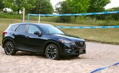 We knew she was versatile, but we didn't know about this hidden talent! Anyone up for a game of beach volleyball? #Mazda #CX5 #Beach