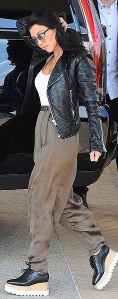 Kourtney Kardashian: Shirt – Wolford  Jacket – Balenciaga  Shoes – Stella McCartney  Sunglasses – Oliver Peoples