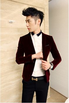 A velvet blazer is stylish, formal, and gender-neutral. Let the bold color of the blazer tell your fashion story. The contrast collar on this shirt is a nice focal point and formal enough to wear without a tie.