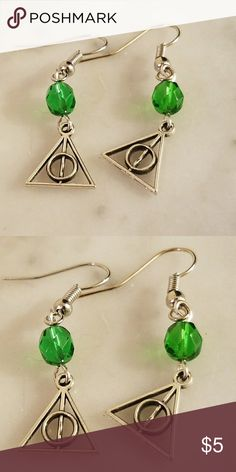Deathly Hallows Earrings Medium sized bright green glass beads with Deathly Hallows charms. Silver plated hooks and hardware.   Magen's Fairytale Creations original handmade by me. Jewelry Earrings