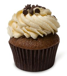 Chocolate Cookie Monster – A darker take on a customer fave! Our signature chocolate cupcake hugs a ball of chocolate chip cookie dough in its tender little center. Topped with mind-blowing cookie dough buttercream and mini chocolate chips.