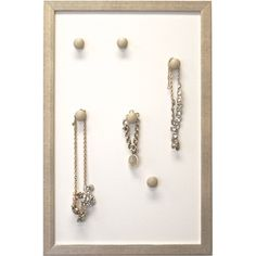 Adjust the knobs to the perfect height to store your pendant necklaces, bangles, and charms on this stylish board, an essential addition to the master suite ...