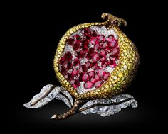 Michelle Ong ~ White, Fancy Intense Yellow and Brown Diamond and Ruby brooch set in 18K White and Yellow Gold.