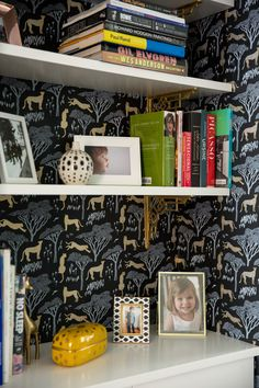 The wallpaper is Hygge & West's Julia Rothman Serengeti pattern in Ebony.  better picture of wallpaper