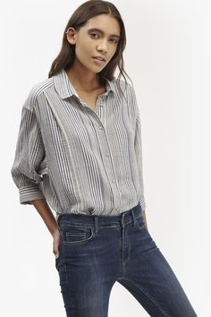 "<ul> <li> Textured, long-length cotton-flax shirt with stripes</li> <li> Mandarin collar with bib</li> <li> Short, bellow sleeves</li> <li> Curved hem and dipped back</li> <li> Half button-through placket at front</li> <li> Easy, loose fit</li> <li> Cropped bellow sleeves</li> <li> UK size M length is 74cm</li> </ul>  <strong>Our model is 5ft 10"" and is wearing a UK size S. </strong>"