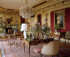 The Drawing Room at Polesden Lacey, Surrey, England, looking towards the fireplace and the inner wall with portrait of 'Margaret McEwan, Mrs Ronald Greville' by H. Smiechen.