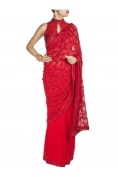 Maroon Embroidered georgette Saree with sleeveless rawsilk cutdana embroidered blouse .