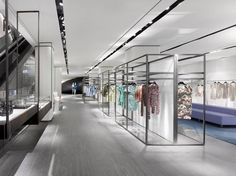 To create points of memory, and to lessen the visual vastness, the space is punctuated with exclusive design elements, including sculptural walls and a bean-shaped fitting room on a women's floor, a sculptural room on the men's department floor, and specialty, decorative lighting details in homewares – all referencing the store's imaginative locale.