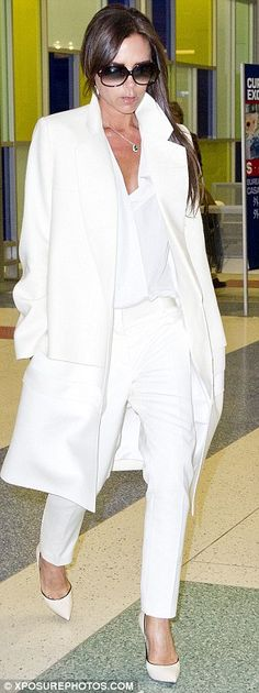 Victoria Beckham.. overcoat, tailored trousers, pleated blouse, sunglasses and over-sized envelope clutch - all in white and from her Pre-AW 2014 collection..