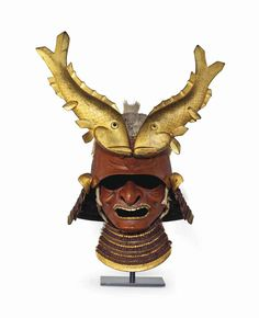 Momoyama period (late 16th century) A zunari (head-shaped) three plate iron of 'yaro-to' (rough fellow's head) shape with boar's bristle forming the hair with a tied top-knot, the mabisashi of a further plate of red-lacquered iron forming a high forehead, maedate (fore-crest) of two opposed carp of wood with gold.