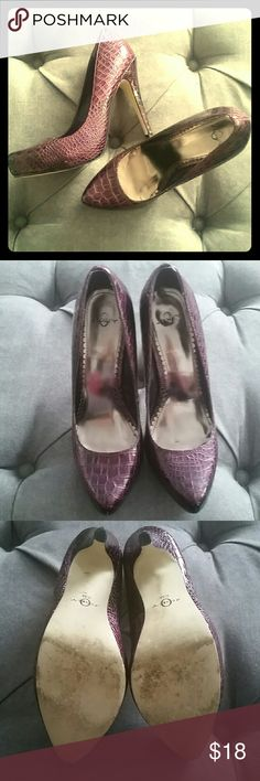 Purple sexy heels! Size 8 Joey high heels. In very good used condition. See up close pics for minor ding on heel and toe. These are a little bit shiny, kind of a purple snake skin texture. You will get tons of compliments on these! Joey Shoes Heels
