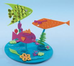Swimming Fish Scene. Can make a cute kids party centerpiece or a playdate project. Just use playdoh for water, pipecleaners, and have the kids cut out felt fish, rocks, etc.