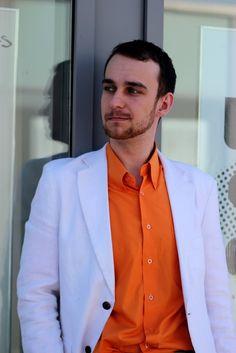 White jacket with orange shirt