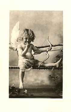 Vintage photo of child playing Cupid.