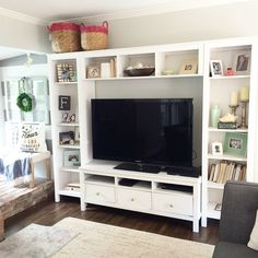 Yesterday I did a spring/summer facelift to our entertainment center. Added some shells, and more pops of coral and greens. If your husband is like mine its go big or go home with the television. So making it pretty is a challenge. When we moved in three years ago, a built in entertainment was not in the budget, so we decided on a ikea unit. We couldn't be happier with our super affordable option and I like that I can still make this monster of a tv look somewhat pretty.
