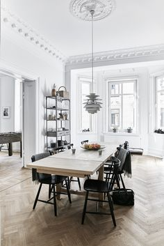 A Snowball pendant by Poul Henningsen for Louis Poulsen hangs in the dining room; the J46 chairs are by Poul M. Volther.