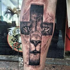 Lion cross tattoo                                                                                                                                                     More