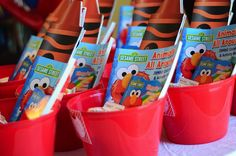 Favors for an Elmo party - this is a cute idea!  How many kids would be there?!!?